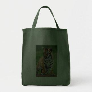 A cute baby tiger bags