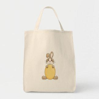 cute easter bunny with yellow egg tote bag