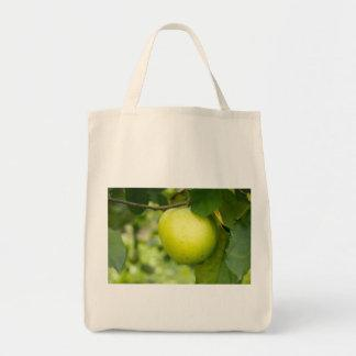 Green Apple on a Tree Branch Bags