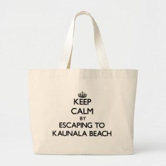 Keep calm by escaping to Kaunala Beach Hawaii Tote Bags