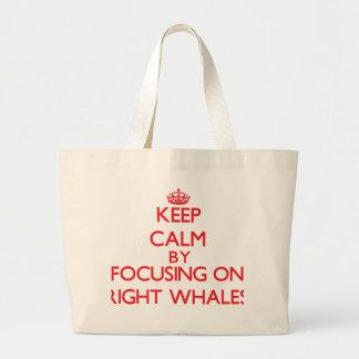 Keep calm by focusing on Right Whales Canvas Bags