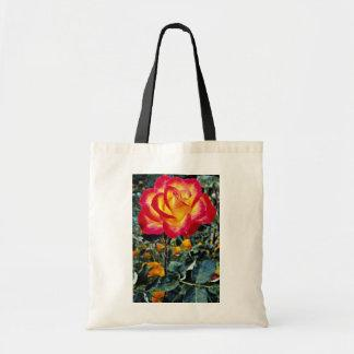Luminous red and yellow rose with raindrops canvas bag