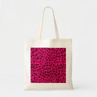 Neon pink leopard print pattern tote bags