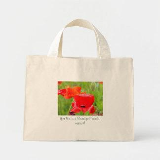 You live in a beautiful world, enjoy it! Red Poppy Tote Bags